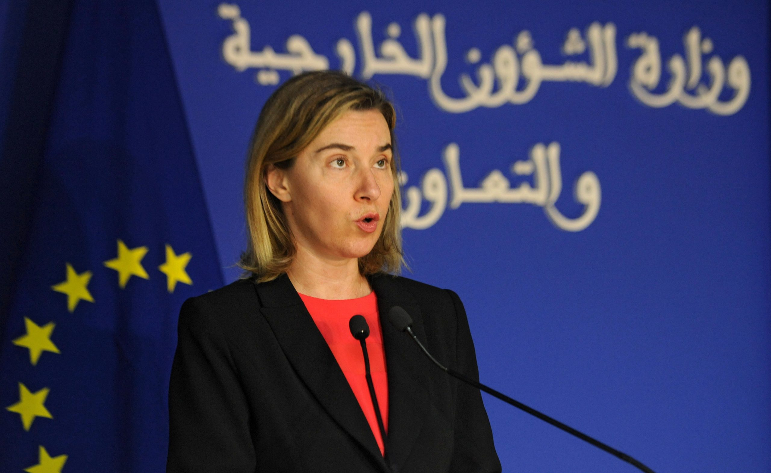Federica Mogherini wearing a suit and tie