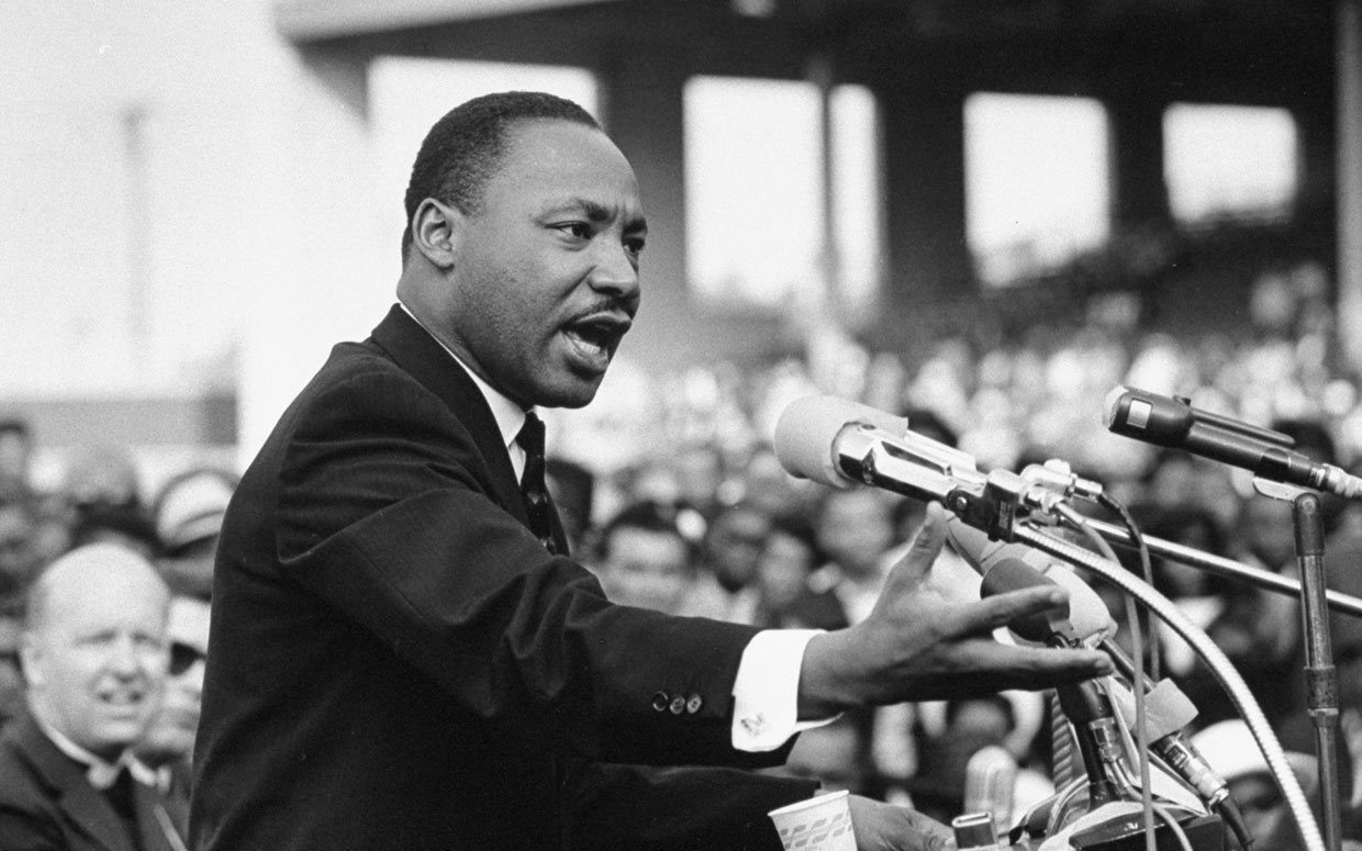 Martin Luther King, Jr. holding a bicycle